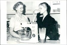 Daily Mail Ideal Home Exhibition 1957, Kenwood Chef lady drinking milk   JD.738