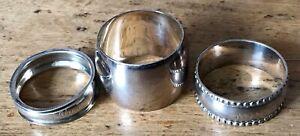 Three napkin rings:silver Birmingham 1898 'Alan', plated brass 'Millie', & plain