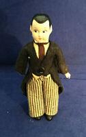 Vintage 6.5 inch Groom Doll felt tuxedo, side glancing blue eyes