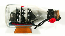 "Nice smaller pirate ship in glass bottle 4 3/4"" x 2 3/4"" black full sails"