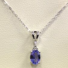 AAA 8mm * 6 mm 1.25Ct Oval Tanzanite and Diamond Pendant Crafted in White Gold.