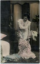 Original vintage 1900s lady, risque dress, cleavage, undressing