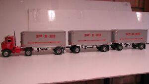 FIRST  GEAR - KENWORTH - DAY CAB -  TRIPLES  --  P.I.E.