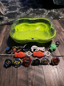 Beyblade Burst Lot with Hyper Sphere Arena, 6 beyblades, and 5 launchers.