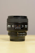 Nikon AF Nikkor 85mm f/1.8D lens, good glass, decent exterior cosmetics