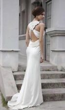Brand new, never worn backless wedding dress size 10