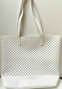 Clinique White Tote with cutouts new without tags great beach bag