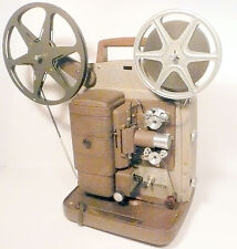 working 8mm BELL & HOWELL quiet/ REVERSE/ stop mo/ SPEED CONT -2 Movies Included