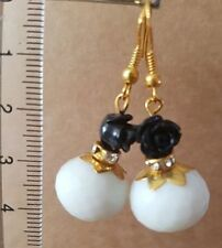 Gold tone white earrings with natural agate and black acrylic petals