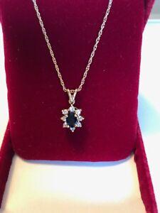 New bright navy blue sapphire and diamond pendant.