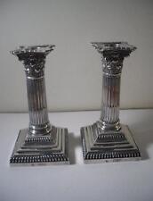 A Pair of Antique Silver Corinthian Column Candlesticks: London 1895