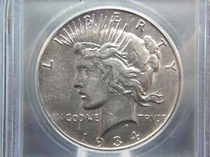 """1934 """"S"""" Peace Silver Dollar ICG AU50  East Coast Coin & Collectables, Inc."""