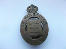 on war service  1915 ordnance workers numbered  badge  R  prefix