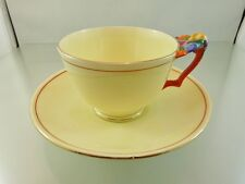 FLOWER ORANGE HANDLE BUTTER YELLOW TEA CUP & SAUCER SET BY CROWN STAFFORDSHIRE