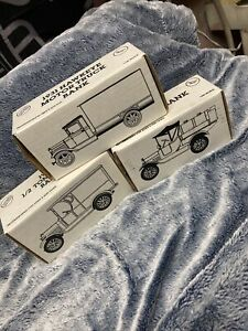 Diecast plastic truck banks by Earl