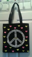"PEACE TOTE BAG. MULTI COLOR HEARTS.  APRX 15"" T, 14"" W. HANDLE 11"".NEVER USED."