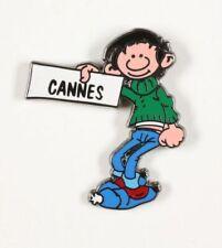 Pin's Gaston Lagaffe Gaston Lagaffe fait du stop pour Cannes Corner