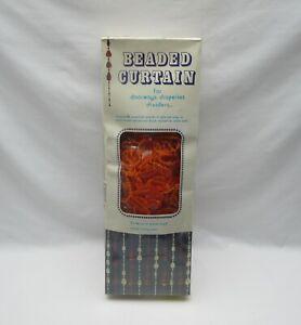 Genuinely retro  orange plastic beaded curtain Width 36ins boxed, sealed