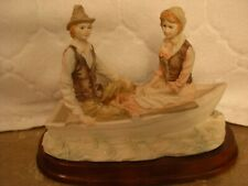 Courting Couple Row Boat Figurine Pastel colors very nice Long ago Romance Love