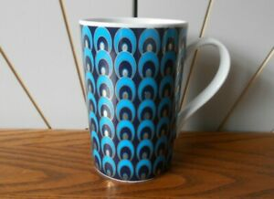 PEACOCK ceramic, porcelain tea or coffee mug PIED A TERRE HOME blue, gold, white