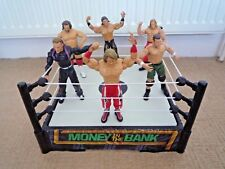 WWE / WWF MONEY IN THE BANK WRESTLING RING WITH SPRING BASE & 6 WRESTLERS