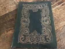 Antique Leather book cover intricate embossed vibrant blue inside