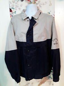 Cutter & Buck Men's L Vented Spell Out Wind Jacket, Navy/Beige. A-5