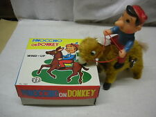 "PINOCCHIO ON DONKEY WIND UP PELOUCHE-TIN TOY ""R"" #463 made in JAPAN it works MIB"