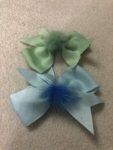 two mini fluffy bows