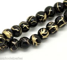 30 perles de verre  6 mm noir et or