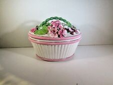 hand crafted ceramic basket with floral lid