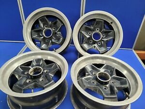 Genuine Porsche Cookie Cutters Set of 4  Alloy Wheels Black with Polished Rim