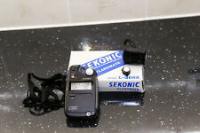 A Sekonic L308S flash light meter.
