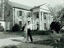 Elvis Presley -  Elvis outside Graceland right after he purchased it in 1957.