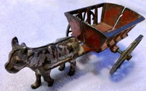 ANTIQUE CAST IRON OX PULLING YELLOW CART TOY