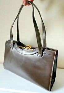 Vintage Dark Brown Leather Kelly/Handbag. Gold Metal Frame. Two Top Handles.