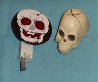 vintage HALLOWEEN SKULL SPARKLER and WIND-UP CHATTERING SKULL toys