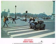 A VIEW TO A KILL ORIGINAL LOBBY CARD CAR SPLITS IN HALF IN PARIS STREET