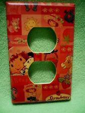 Vintage colorful Strawberry Shortcake designs wrapped paper outlet cover.