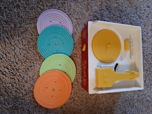 Fisher price music box record player with 4 records/8 songs