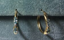 10k Hoop Earrings with Oval Blue Topaz and Diamonds