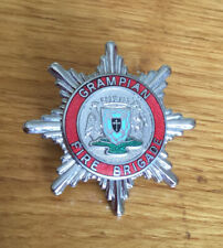 An old Grampian  Fire Brigade, cap badge.Enamel Centre.