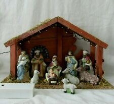 Small Porcelain Nativity In Wooden Stable With Battery Operated Lights