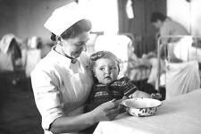 Photo. 1948-9. Israel. Nurse & Immigrant Infant
