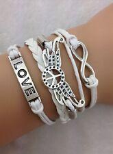Bracelet blanc  peace and love avec ailes d'ange,  love et lien infini