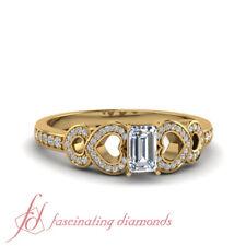 One Carat Emerald Cut Diamond Graduated Heart Design Yellow Gold Engagement Ring