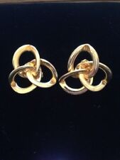 intage gold coloured metal knot clip on earrings