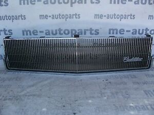 1985-1986 CADILLAC DEVILLE FLEETWOOD FWD FACTORY GRILL GRILLE W/ EMBLEM 16285382