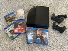 Sony PlayStation 4 mit 2 Controllern und 6 Spielen