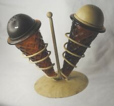 Vintage salt and pepper shaker set, ice cream cones, amber glass w/ metal stand